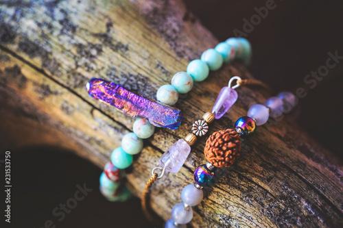 Natural gemstone beads bracelets on wooden background Fototapeta