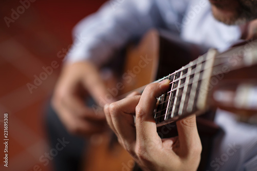 Leinwand Poster Close up of guitarist hand on classical guitar
