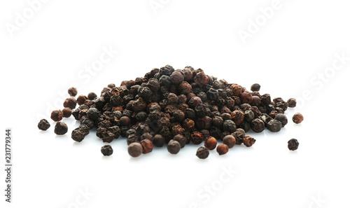 Black pepper grains on white background. Natural spice