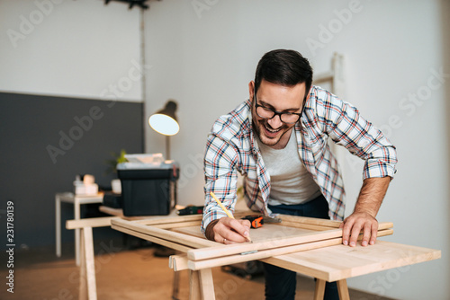 Happy young man working on DIY project.