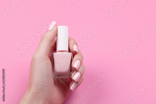 Canvas Print girl holds nail polish with a beautiful manicure