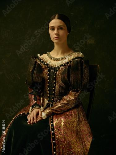 Fényképezés Portrait of a girl wearing a princess or countess dress over dark studio
