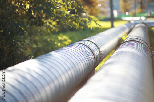 Photo Industrial pipes on street construction