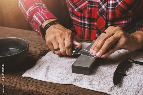 Fototapeta pocket knife maintenance and sharpening