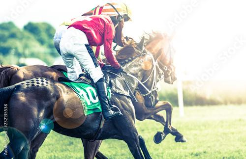 Race horses and jockeys racing into the sun, cross processed sun flare effect