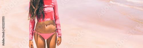 Wallpaper Mural Rashguard solar protection swimwear in pink for women fashion, Bikini woman body lifestyle banner panorama