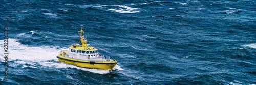Coast guard boat patrol riding on rough sea waves in Alaska Fototapet