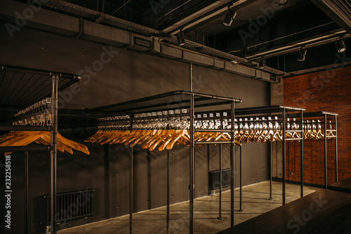 Wooden hangers with numbers in dark empty cloakroom or checkroom or wardrobe Fototapeta