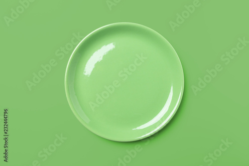Green pastel plate on same colored background.