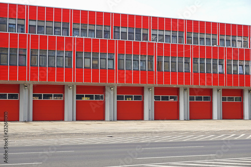 Fototapeta Fire station with garages in the city