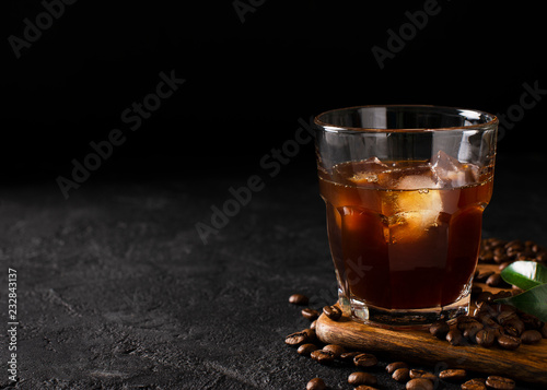Tableau sur Toile glass cold brew coffee with ice on black or dark background
