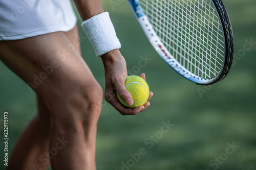 Tennis player in sportswear with a ball