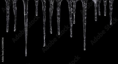 Fotografia Close up of icicles isolated on black background