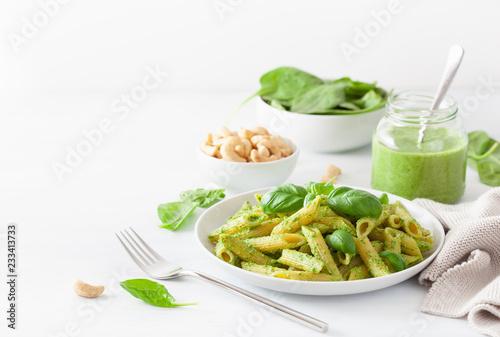 Obraz na płótnie penne pasta with spinach basil pesto sauce