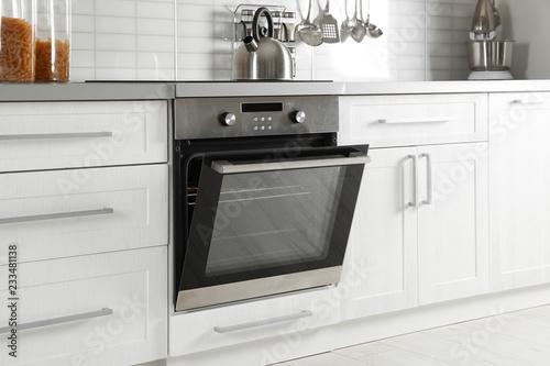 Fotografie, Tablou Open modern oven built in kitchen furniture