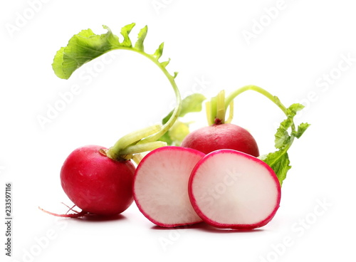 Fresh red radishes slice with leaves isolated on white background