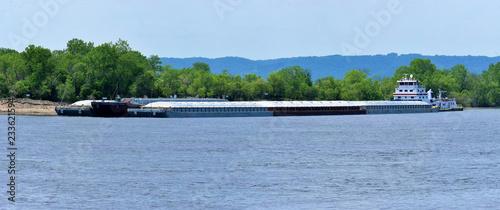 Slika na platnu multiple barges being transported on the mississippi river