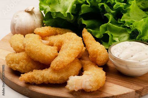 Delicatessen shrimp in breaded closeup with salad