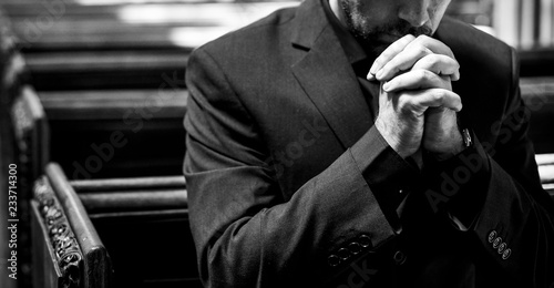 Canvas Print Lonely Christian man praying in the church