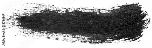 Fotografia Long hand drawn isolated paintbrush stripe with dirty black color ink