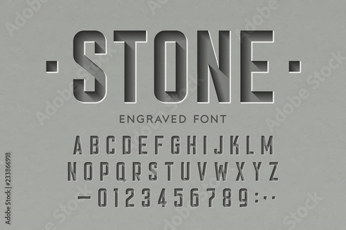 Carta da parati Engraved on stone font, alphabet letters and numbers