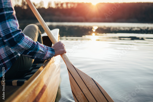 Canvas Print Close up of hipster girl holding canoe paddle