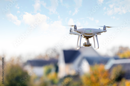 drone flying front of home