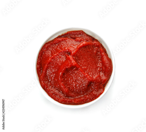 Tasty homemade tomato sauce in bowl on white background, top view