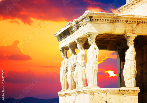 details of Erechtheion temple in Acropolis of Athens at sunset, Greece