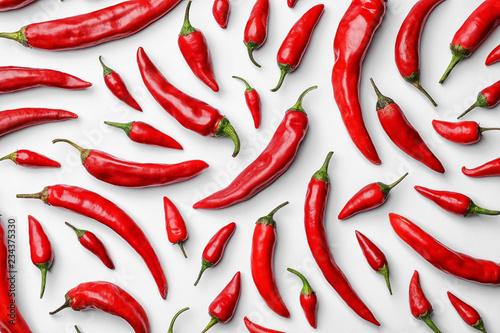 Fotografie, Obraz Flat lay composition with fresh chili peppers on white background