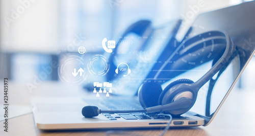 Fotografia close up soft focus on headset with telephone devices at office desk for custome