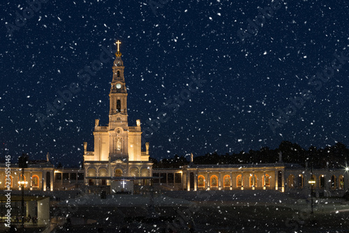 Merry Christmas Card, Snowing night in the Sanctuary of Fatima, Portugal.
