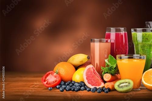 Carta da parati Tasty fruits  and juice with vitamins on background
