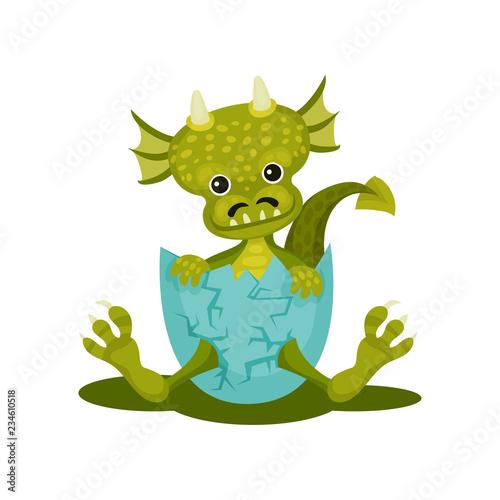 Fototapeta Funny baby dragon in blue broken egg shell