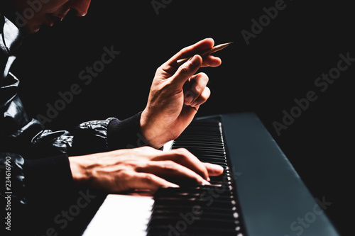 Obraz na plátně male songwriter hands composing a song on piano, song writing concept