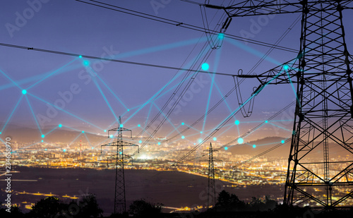 Canvas Print High power electricity poles in urban area connected to smart grid