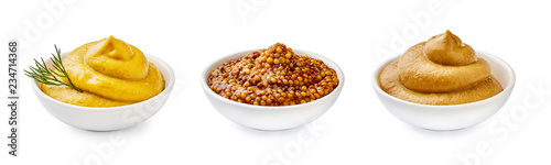 Fotografia Mustard in bowls. Set of sauce isolated on white background.