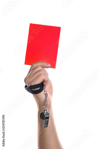 Football referee with whistle holding red card on white background, closeup