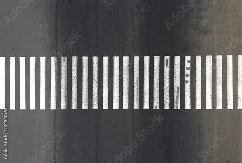 Fotografia Aerial. Pedestrian crosswalk zebra with no pedestrians. Top view.