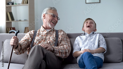 Obraz na plátně Old man and boy laughing genuinely, joking, valuable fun moments together