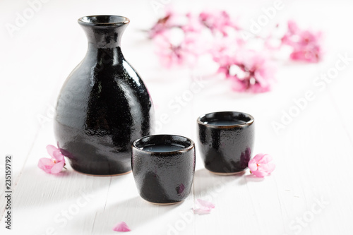 Unfiltered white sake with flowers of blooming cherry