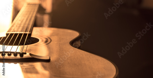 acoustic guitar close-up on a beautiful colored background