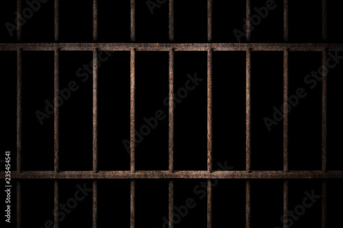 Photo Old prison rusted metal bars cell lock with dark and bright in the jail