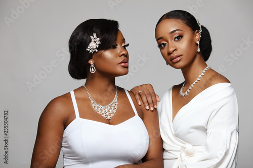 Canvas-taulu Two happy and beautiful black skin woman