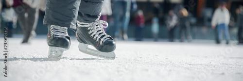 Fototapeta People ice skating on ice rink
