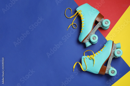 Fotografie, Obraz Pair of stylish quad roller skates on color background, top view with space for