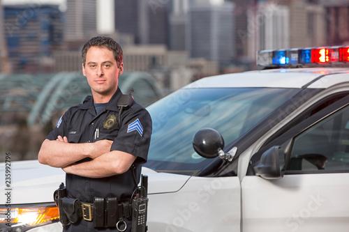 Wallpaper Mural Police sergeant leaning agains car