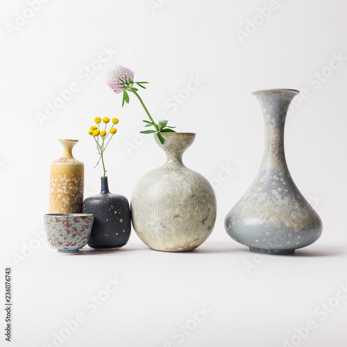 Vászonkép Ceramic vases with flowers
