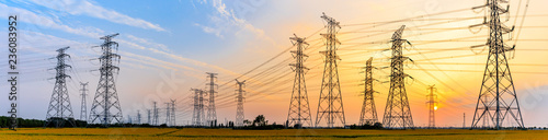 Photo high-voltage power lines at sunset,high voltage electric transmission tower