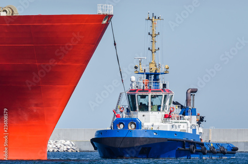 TUGBOAT AND SHIP - Ships maneuver in the port